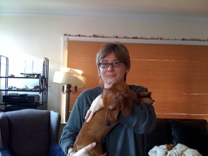 Here I am more than 35 years later with Oliver, the dachshund.